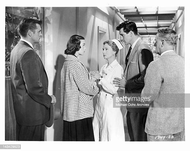 Agnes Moorehead consoles Barbara Rush as Rock Hudson watches attentively in a scene from the film 'Magnificent Obsession' 1954