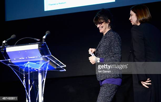 Agnes Sire, winner of the Best Photography Book award and award presenter Kate Bush on stage at the 2014 Sony World Photography awards at the London...