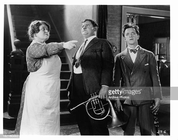 Agnes Steele directs Oliver Hardy and Stan Laurel in a scene from the film 'You're Darn Tootin' 1928