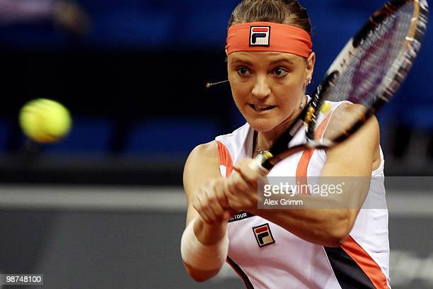 Agnes Szavay of Hungary plays a backhand during her second round match against Dinara Safina of Russia at day four of the WTA Porsche Tennis Grand...