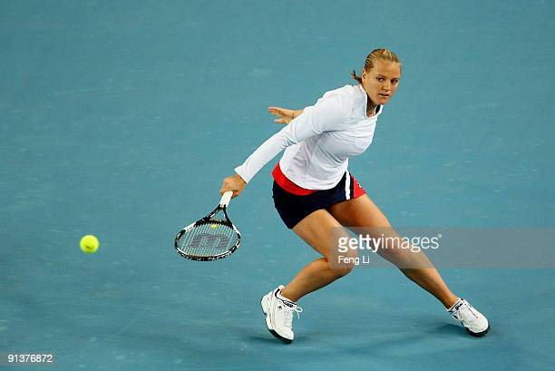 Agnes Szavay of Hungary plays a backhand in her first round match against Alona Bondarenko of Ukraine during the 2009 China Open at the Beijing...