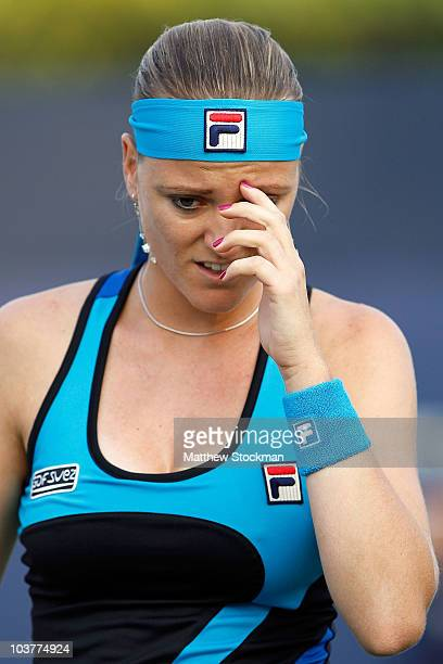 Agnes Szavay of Hungary reacts after a point against Flavia Pennetta of Italy during her second round women's singles match on day three of the 2010...