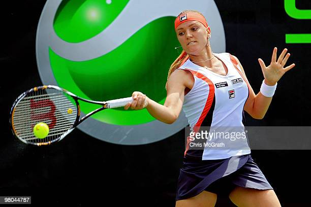 Agnes Szavay of Hungary returns a shot against Alicia Molik of Australia during day three of the 2010 Sony Ericsson Open at Crandon Park Tennis...