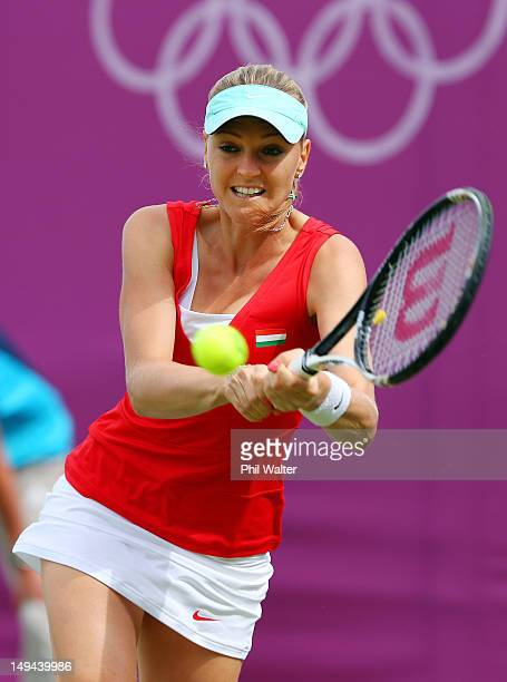 Agnes Szavay of Hungary returns a shot against Elena Baltacha of Great Britain during her Women's Singles Tennis match on Day 1 of the London 2012...