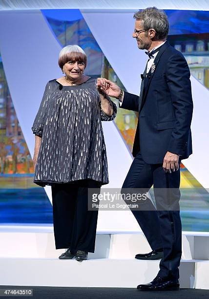 Agnes Varda and Lambert Wilson attend the closing ceremony during the 68th annual Cannes Film Festival on May 24 2015 in Cannes France