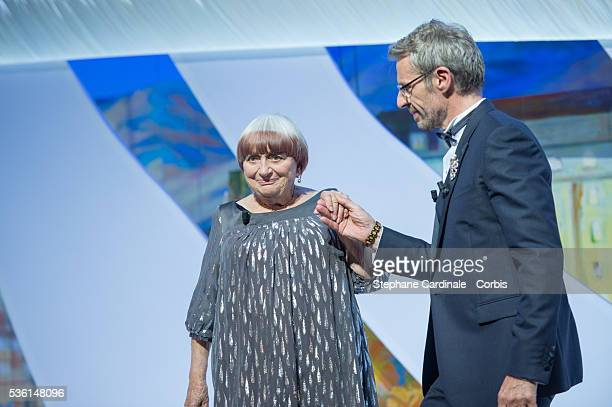 Agnes Varda and Lambert Wilson onstage at the closing ceremony during the 68th annual Cannes Film Festival on May 24, 2015