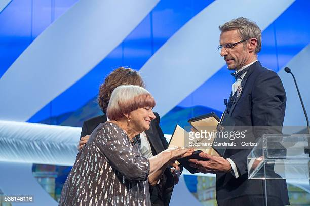 Agnes Varda and Lambert Wilson onstage at the closing ceremony during the 68th annual Cannes Film Festival on May 24 2015
