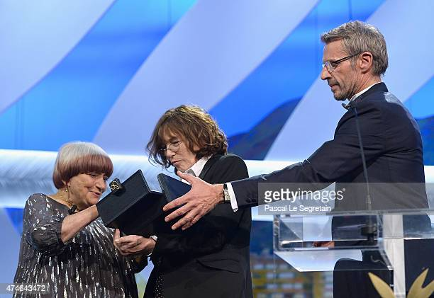 Agnes Varda receives an honourary Palme d'Or from actress and singer Jane Birkin and Master of Ceremony Lambert Wilson attends the closing ceremony...