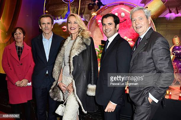 Agnes Vigneron Guillaume Houze Jerry Hall Nicolas Houze and Philippe Houze attend Christmas decorations inauguration at Galeries Lafayette on...