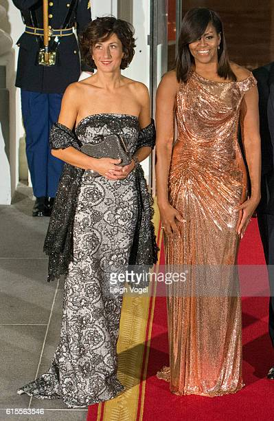 Agnese Landini and First Lady Michelle Obama arrive for the state dinner at the White House on October 18 2016 in Washington DC