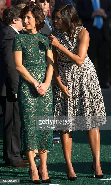 Agnese Landini and First Lady Michelle Obama listen to remarks during a state arrival ceremony on The South Lawn at The White House on October 18...