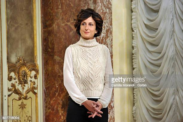 Agnese Landini listens to her husband, Italian Prime Minister Matteo Renzi, as he speaks at a press conference to acknowledge defeat in a...