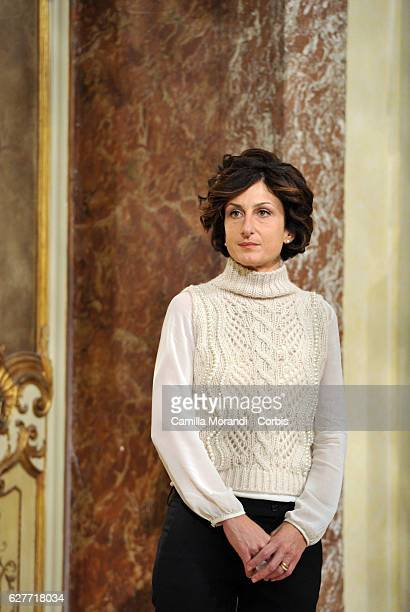 Agnese Landini listens to her husband Italian Prime Minister Matteo Renzi as he speaks at a press conference to acknowledge defeat in a...