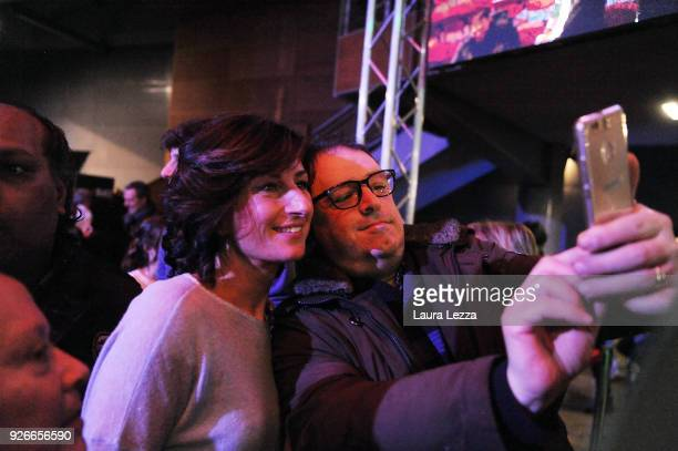 Agnese Renzi takes a selfie photo with a supporter while her husband the Italian politician and leader of the Democratic Party Matteo Renzi closes...