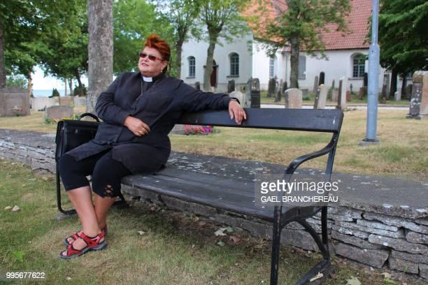 Agneta Soderdahl, priest poses on a bench on Faroe, Sweden, an island in the Baltic sea where Swedish director Ingmar Bergman shot several motion...