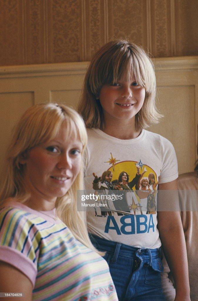 Agnetha Faltskog smiling posing with her daughter wearing a T-shirt 'Abba'.
