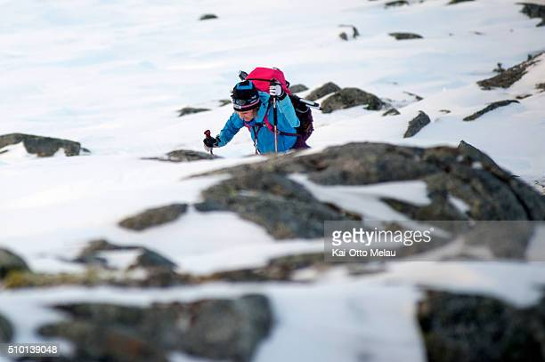 Agnethe Bergsaker making her way up the mountain pass on February 13 2016 in Svolvar Norway The water temperature is around 4c and after the swimleg...