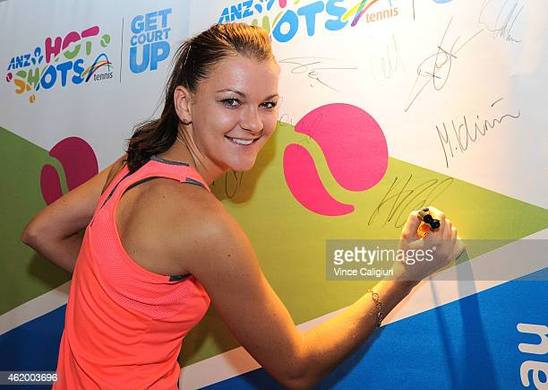 Agnieska Radwanska of Poland signing autographs at Autograph Island during the 2015 Australian Open at Melbourne Park on January 23 2015 in Melbourne...