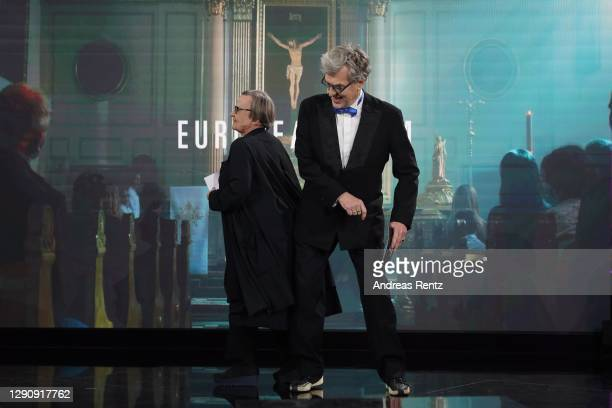 """Agnieszka Holland and Wim Wenders present the European Film award to Thomas Vinterberg and Kasper Dissing for """"Another Round"""" on stage at the 33rd..."""