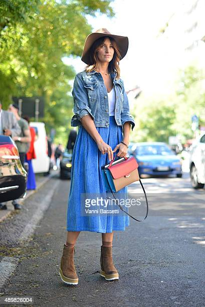 Agnieszka Ptak poses wearing a Department 5 skirt Pinko jacket Fendi 2jours bag and La Corde Blanche shoes before the Fendi show during the Milan...