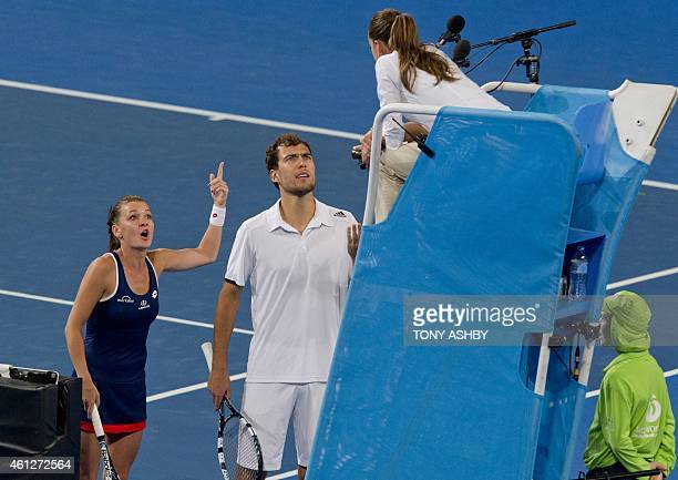 Agnieszka Radwanska and Jerzy Janowicz of Poland dispute chair umpire Marijana Velvojic's call against Serena Williams and John Isner of the US...
