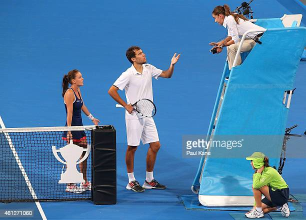 Agnieszka Radwanska and Jerzy Janowicz of Poland question a call with chair umpire Marijana Veljovic in the mixed doubles final against Serena...