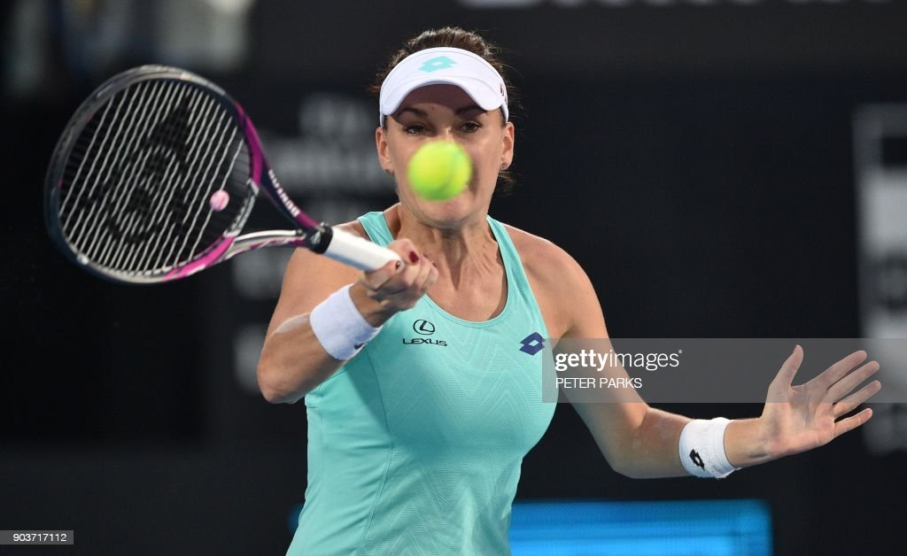 Agnieszka Radwanska hits a return to Camila Giorgi of Italy in their women's singles quarter-final match at the Sydney International tennis tournament in Sydney on January 11, 2018. /