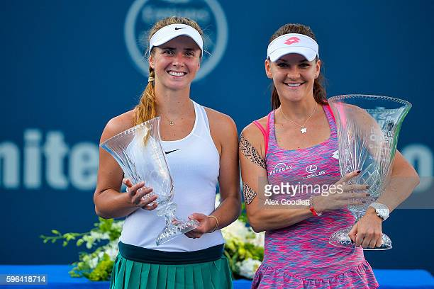 Agnieszka Radwanska of Poland and Elina Svitolina of Ukraine pose for a picture after their women's singles final on day 7 of the Connecticut Open at...