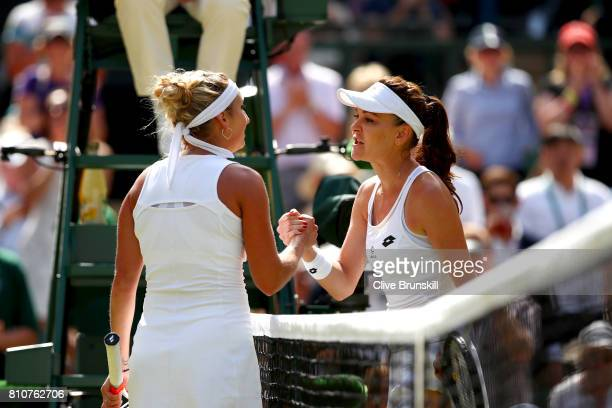 Agnieszka Radwanska of Poland and Timea Bacsinszky of Switzerland shake hnads after their Ladies Singles third round match on day six of the...