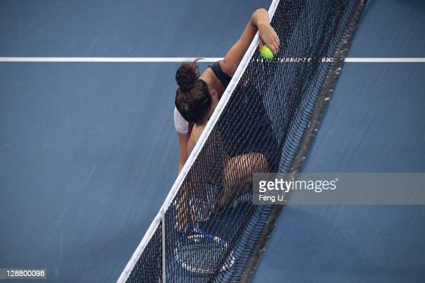 Agnieszka Radwanska of Poland celebrate match point against Andrea Petkovic of Germany in the women's final of the China Open at the National Tennis...
