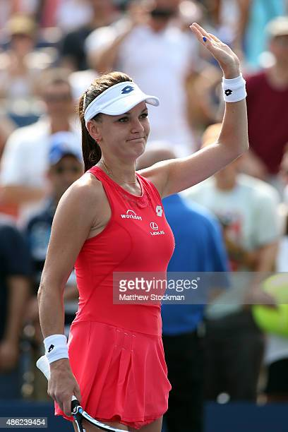 Agnieszka Radwanska of Poland celebrates after defeating Magda Linette of Poland in their Women's Singles Second Round match on Day Three of the 2015...