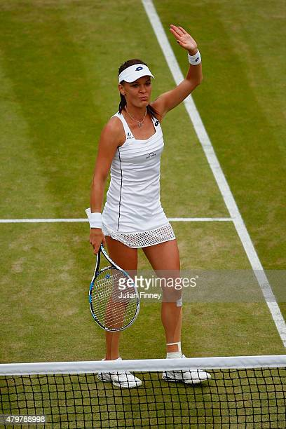 Agnieszka Radwanska of Poland celebrates after winning her Ladies Singles Quarter Final match against Madison Keys of the United States during day...
