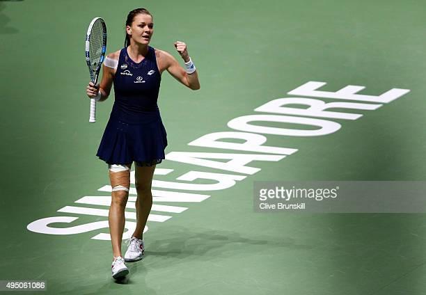 Agnieszka Radwanska of Poland celebrates match point at the semifinal match against Garbine Muguruza of Spain during BNP Paribas WTA Finals at...