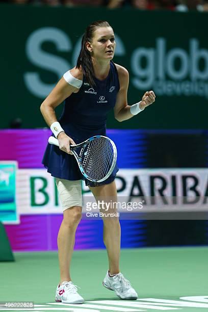 Agnieszka Radwanska of Poland celebrates match point during her finals match against Petra Kvitova of Czech Republic during the BNP Paribas WTA...