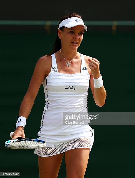 Agnieszka Radwanska of Poland celebrates match point in her Ladies' Singles Fourth Round match against Jelena Jankovic of Serbia during day seven of...