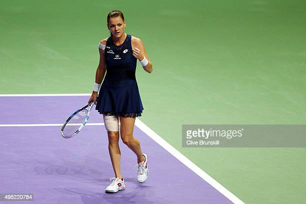 Agnieszka Radwanska of Poland celebrates set point during her final match against Petra Kvitova of Czech Republic during the BNP Paribas WTA Finals...
