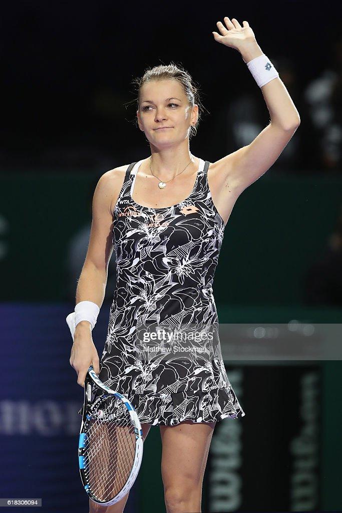 Agnieszka Radwanska of Poland celebrates victory in her singles match against Garbine Muguruza of Spain during day 4 of the BNP Paribas WTA Finals Singapore at Singapore Sports Hub on October 26, 2016 in Singapore.