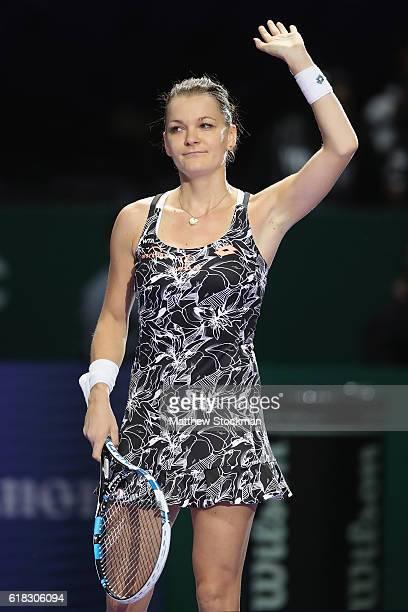 Agnieszka Radwanska of Poland celebrates victory in her singles match against Garbine Muguruza of Spain during day 4 of the BNP Paribas WTA Finals...