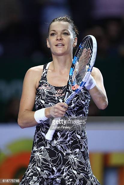 Agnieszka Radwanska of Poland celebrates victory in her singles match against Karolina Pliskova of Czech Republic during day 6 of the BNP Paribas WTA...