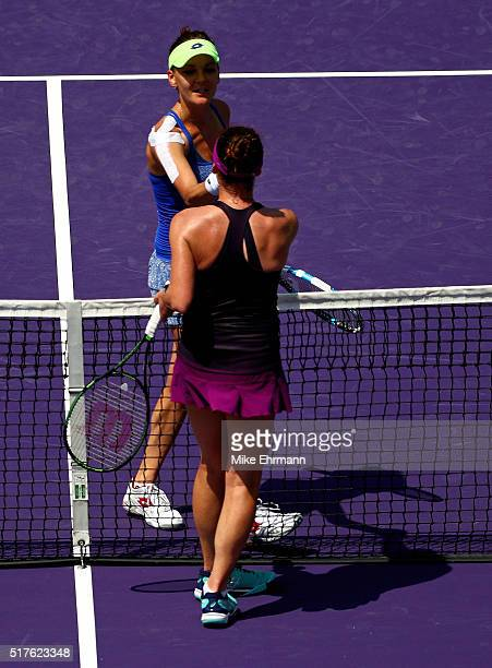Agnieszka Radwanska of Poland celebrates winning a match against Madison Brengle during Day 6 of the Miami Open presented by Itau at Crandon Park...