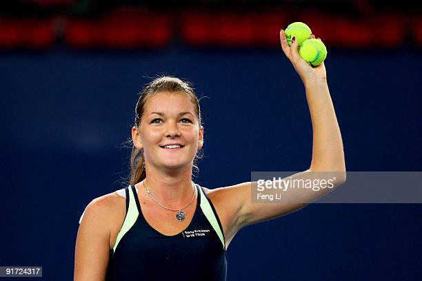 Agnieszka Radwanska of Poland celebrates winning against Marion Bartoli of France in the Semifinals during day nine of the 2009 China Open at the...