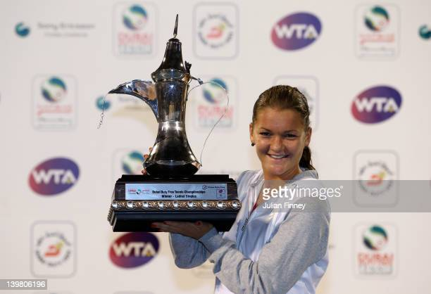 Agnieszka Radwanska of Poland celebrates with the trophy after defeating Julia Goerges of Germany in the final during day six of the WTA Dubai Duty...
