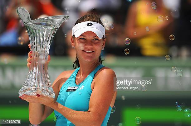 Agnieszka Radwanska of Poland celebrates with the trophy after beating Maria Sharapova of Russia in the women's singles final on day 13 of the Sony...