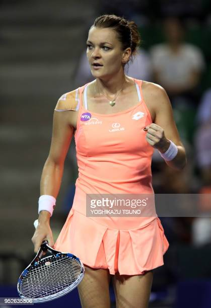 Agnieszka Radwanska of Poland clinches her fist during the quarter finals of the Toray Pan Pacific Open tennis championships in Tokyo on September 23...