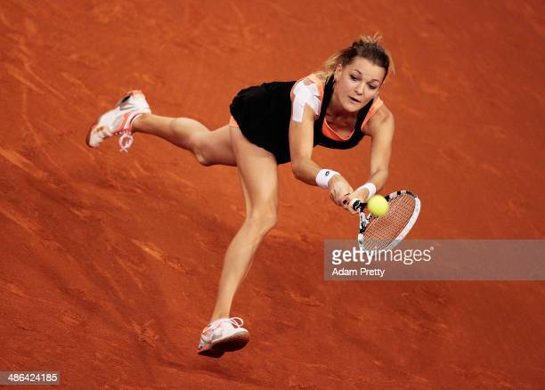 Agnieszka Radwanska of Poland hits a backhand during her match against Roberta Vinci of Italy on day four of the Porsche Tennis Grand Prix 2014 at...