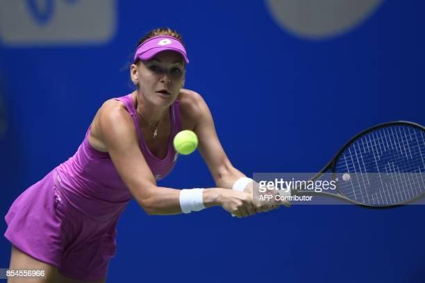 Agnieszka Radwanska of Poland hits a return against Ashleigh Barty of Australia during their third round women's singles match at the WTA Wuhan Open...