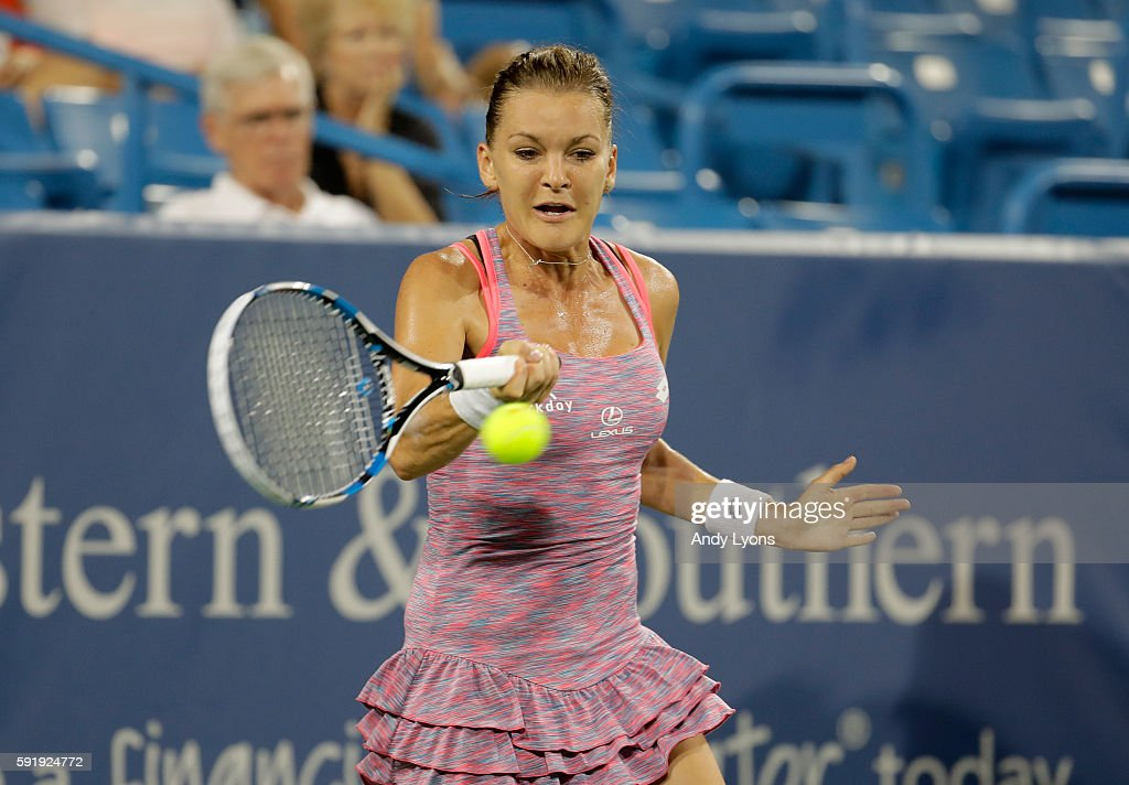 Agnieszka Radwanska of Poland hits a return in her third round match against Johanna Konta during day 6 of the Western & Southern Open at the Lindner Family Tennis Center on August 18, 2016 in Mason, Ohio.
