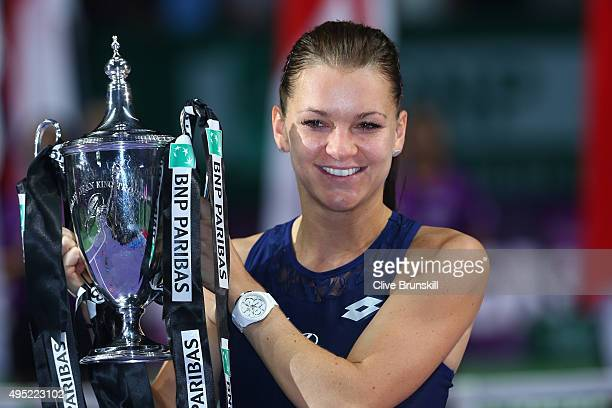 Agnieszka Radwanska of Poland holds the Billie Jean King Trophy after defeating Petra Kvitova of Czech Republic in the final match during the BNP...