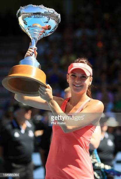 Agnieszka Radwanska of Poland holds the trophy following the final against Yanina Wickmayer of Belgium during day six of the 2013 ASB Classic at ASB...