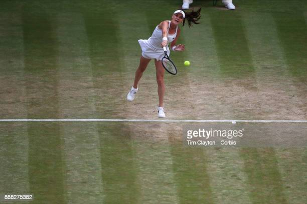 Agnieszka Radwanska of Poland in action against Times Bacsinszky of Switzerland on Centre Court during the Wimbledon Lawn Tennis Championships at the...